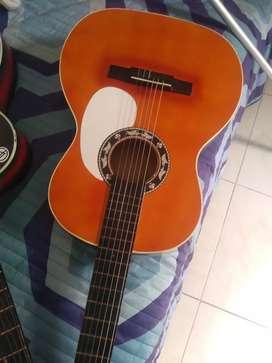 Vendo o cambio guitarra tipo española con forro semiduro