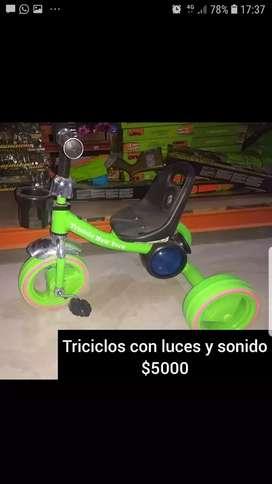 Triciclo con luz y sonido.