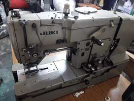 Máquina ojaladora marca Juki