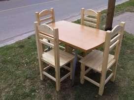 Mesa de 120x70con cuatro  sillaa nuevas