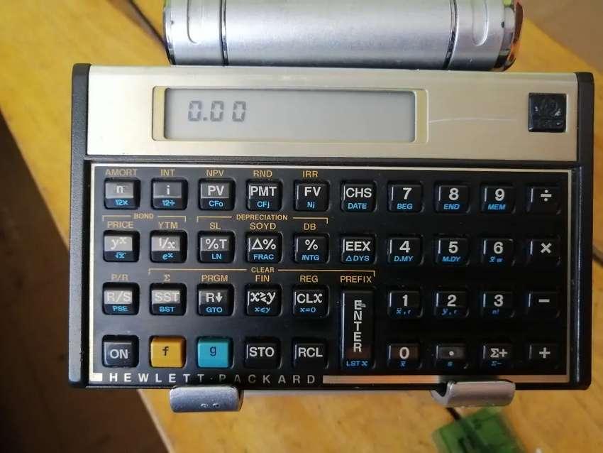 Calculadora financiera HP 12c usada desgaste funcional 0
