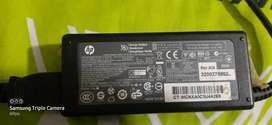 Cargador portátil HP 1000 original punta aguja