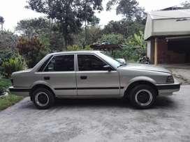 Vendo 323 o permutó x Suzuki 410