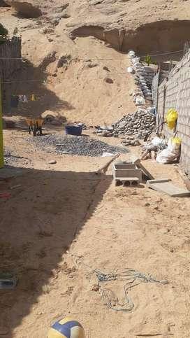 Terreno con casa prefabricada