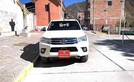 Toyota hi lux color blanco perla