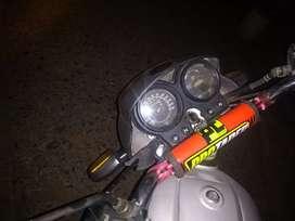 Moto hero honda con remolque resien reparada