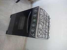 Estufa de piso con horno 4 puestos gris