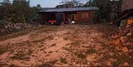 Lote de terreno y casa de madera