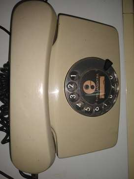 Teléfono disco funciona beige