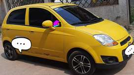 Taxi spark excelente estado