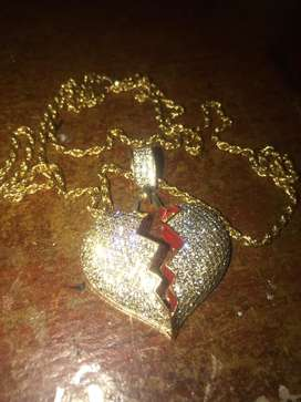 Vendo cadena + dije corazon roto
