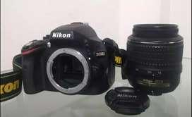 Cámara Nikon D5100 más lente 50mm y accesorios dobles