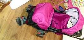 Coche y silla antirreflujo para niña