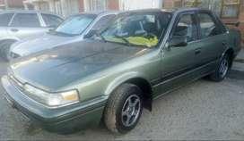 Vendo automóvil Mazda en buen estado, recién pintado, impuestos al día.