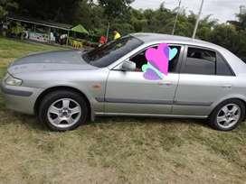 Mazda millenium a muy buen precio seguro y tecno vigentes vidrios polarizados cojineria nueva llantas en buen estado