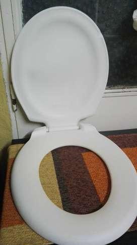 Tabla  o asiento de inodoro como nueva