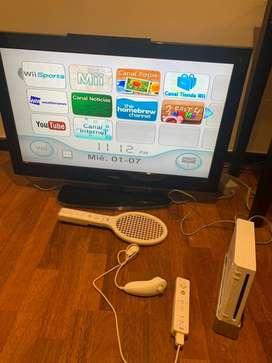 Nintendo Wii - juegos Wii sports y tom ride - dos josticks - un nunchuk- raqueta de tenis