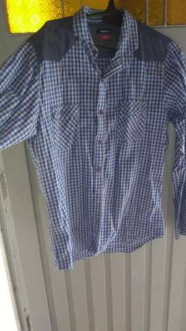 Vendo camisas en exelente estado un sólo uso