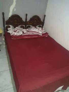 Vendo cama dos Plazas de buena madera