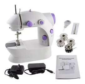 Maravillosa mini maquina de coser.