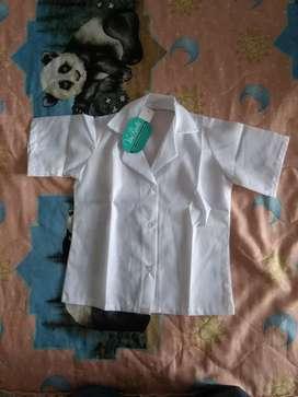 Vendo camisas escolares unisex