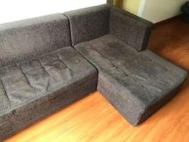 Sofa en L con mesa de centro