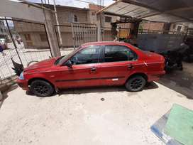 Se vende mi auto rojo marca honda modelo civico del año 1998 con cambio automatico precio 7900 soles  precio negociable