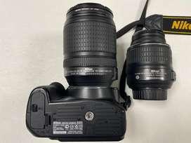 Cámara Nikon D3200 con lente extra y accesorios