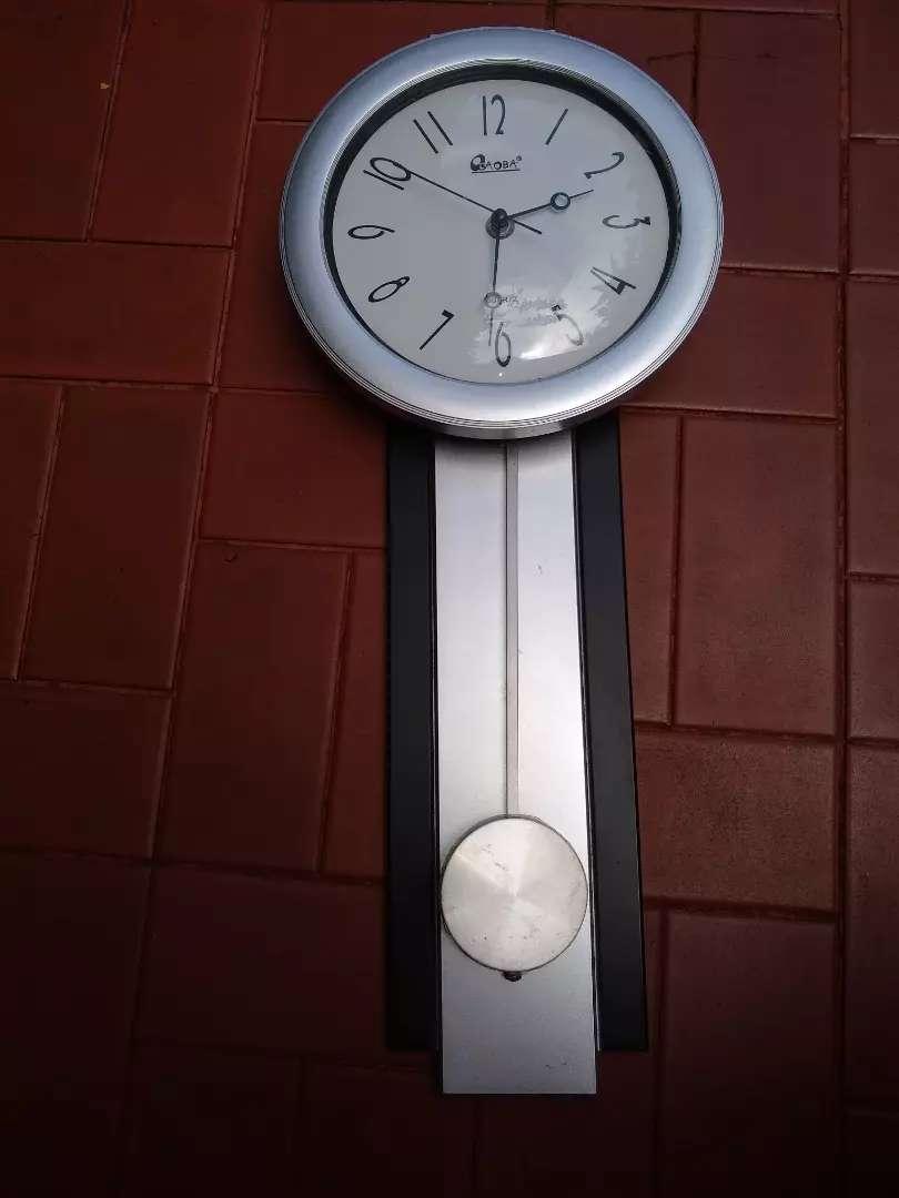 Reloj con pendulo 0