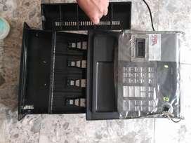 Caja registradora  y pesa