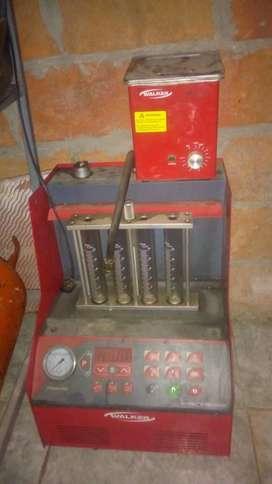 Makina de inyectores y cargadora de bateria