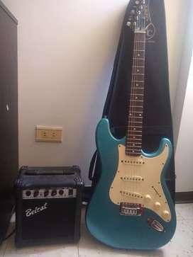Guitarra eléctrica con su amplificador