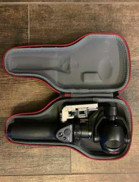 DJI Osmo  Zoom handheld camera de 3 axis 4K mas bateria extra