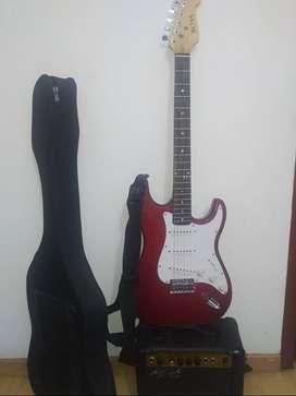 Conjunto de guitarra eléctrica color rojo, marca BOSS. estuche, correa, cable y amplificador marca Mega AMP