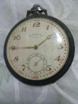 Antiguo reloj de bolcillo oro y plata a cuerda suizo