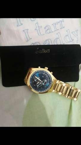 Vendo reloj golden metal