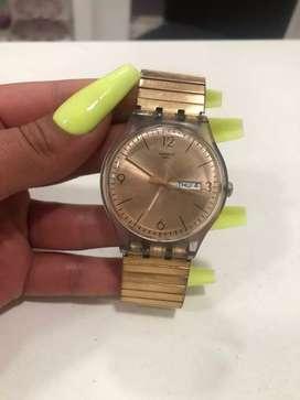 Reloj Swatch de malla eslastizada rosé