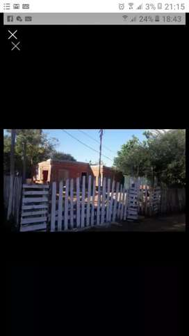 Vendo o permuto terreno con casa de material con permiso