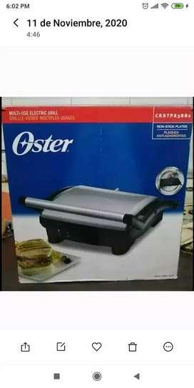 Sanduchera y parrilla Oster de oportunidad. Buen precio , nueva y negociable.