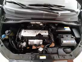 Hyundai getz color gris media noche,1.6 cilindraje vidrios electricos excelente estado