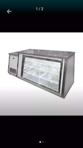 Vendo heladera mostrador un año de uso no mas la vendo en $30.000 resibo permutas y plata o resibo moto y plata