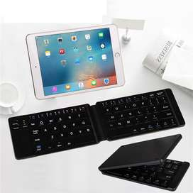 Mini Teclado plegable Bluetooth 3.0 (67 teclas).