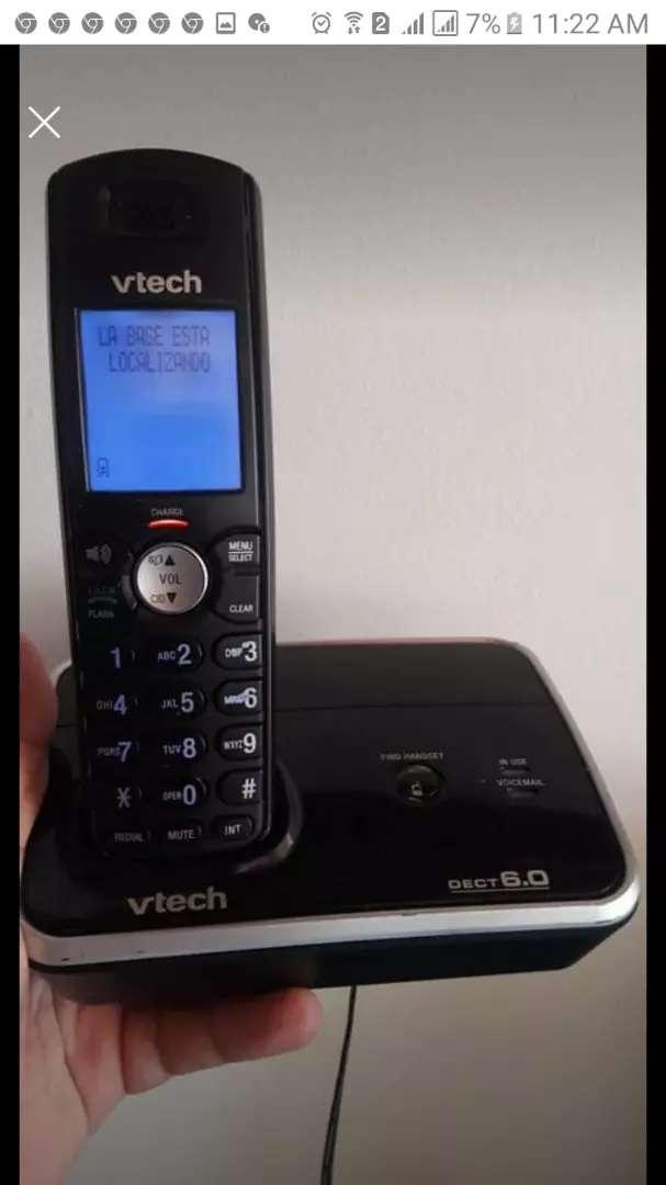 Vtech de pantalla azul con identificador y altavoz 0