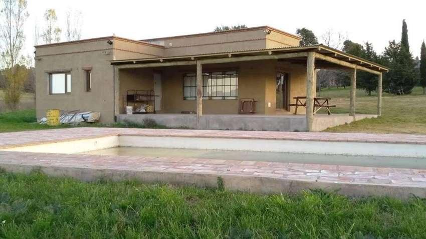 uj05 - Casa para 4 a 10 personas con pileta en Tandil 0