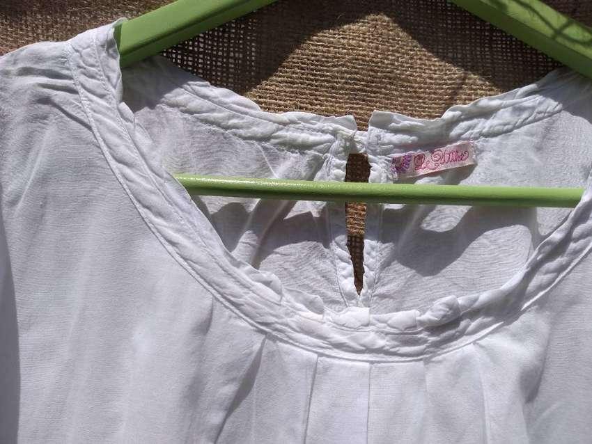 Camisolas y camisas blancas talle M. De marca 0