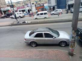 Venpermuto por carro de mayor valor ford laser