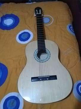 Linda guitarra acústica