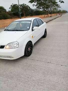 Muy buenas  condiciones carro con placas  serrana tiene aire acondicionado llantas nuevas asientos de cuero negociable