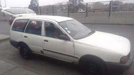 Nissan AD del 97 gnv cancelado blanco con dos balones abajo..