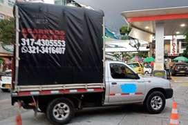 Servicio de viajes y acarreos, local y nacional,,servicio de botar escombros